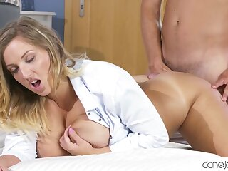 Busty blonde of age gives a blowjob and gets penetrated good