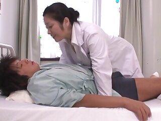 Naughty Japanese doctor Minako Komukai enjoys sucking patient's dick